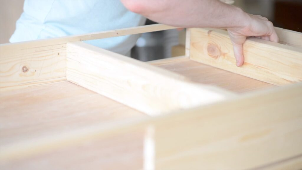 attaching 2x4 braces to the table top