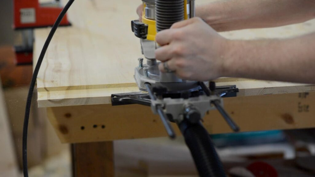 cutting breadboard end with the router