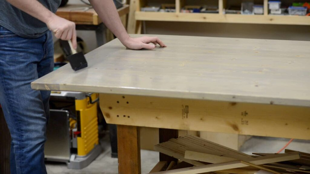 applying finish to a coffee table